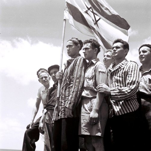 Buchenwald Nazi concentration camp survivors arrive in Haifa, Israel, July 15, 1945 only to be arrested by the British.