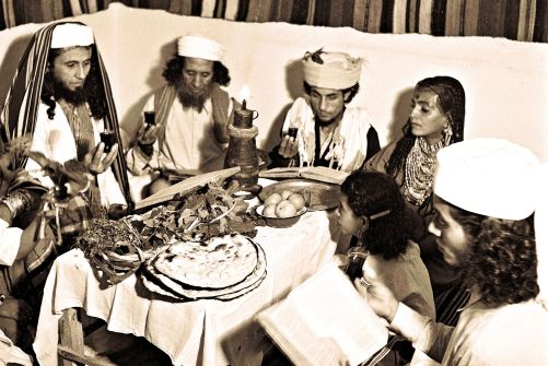 A Yemenite Habani family celebrating Passover in their new home in Tel Aviv.