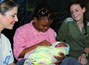 The first baby delivered at the Israel Defense Forces Field Hospital in Port-au-Prince, Haiti, January 17, 2010. After the devastating earthquake which struck Haiti in January 2010, Israel sent an aid delegation of over 250 personnel to help with search and rescue efforts and establish a field hospital in Port-au-Prince. The healthy newborn boy was named Israel!