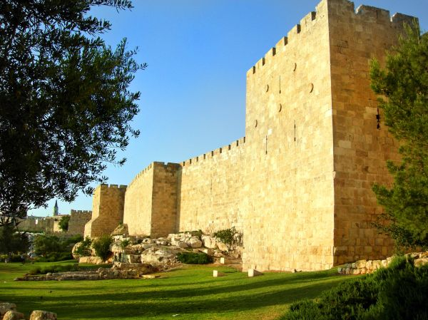 Golden walls of the old city of Jerusalem as sunset approaches.