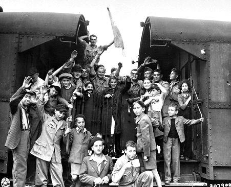 A group of surviving Jewish children wave as they depart by train from the horror of Buchenwald concentration camp. (The Buchenwald children were a group of approximately 1000 Jewish child survivors found by American troops when they liberated the Buchenwald concentration camp on April 11, 1945. Most of the children were originally from Poland, though others came from Hungary, Slovenia and Ruthenia. Unsure of what to do with the child survivors, American army chaplains, Rabbi Herschel Schacter and Rabbi Robert Marcus, contacted the offices of the OSE (Oeuvre de Secours aux Enfants) Jewish children's relief organization in Geneva. They arranged to send 427 of the children to France, 280 to Switzerland and 250 to England.)