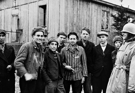 Colonel Hayden Sears (right) poses with a group of survivors in the newly liberated Ohrdruf concentration camp, [Thuringia] Germany, April 4, 1945 - April 30, 1945.