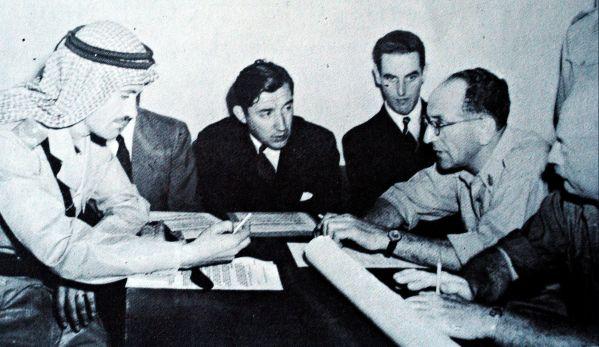 General David Shaltiel, one-time commander of Haganah forces in Jerusalem (in glasses), and Colonel Abdullah El-Tel (in Bedouin headgear) negotiate in Jerusalem the Israel-Jordan Armistice Agreement, which was signed in Rhodes on April 3, 1949. By Israel Defense Forces Archives.