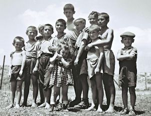 A group of orphans who are survivors of the Holocaust at the reception camp in Atlit, July14, 1944. (The Atlit detainee camp was a detention camp established by authorities of the British Mandate for Palestine at the end of the 1930s in what is now Israel's northern coast, 20 kilometers (12 mi) south of Haifa. The camp was established to prevent Jewish refugees from entering Palestine. Tens of thousands of Jewish immigrants were interned at the camp, which was surrounded by barbed wire and watchtowers. Many of the detainees during the 1930s and 1940s were Jewish refugees from Nazi-controlled Europe. In the late 1940s, most were Holocaust survivors. The British authorities, acceding to Arab demands to limit Jewish immigration, refused to allow them to enter the country.)