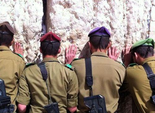 IDF soldiers praying at the Western Wall.