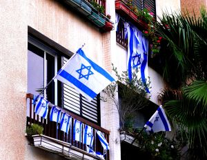 Israeli Independence Day flags flying from balconies in Israel.