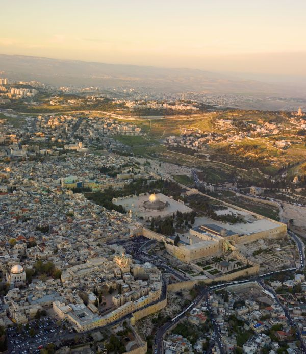Aerial view of Jerusalem at sunset; part of Mount Zion in left foreground.