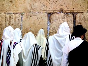 Jewish men praying at the Western Wall.