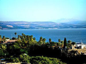 View from Tiberias, Galilee, Israel, northward across the Sea of Galilee with snowy Mount Hermon in the distance.