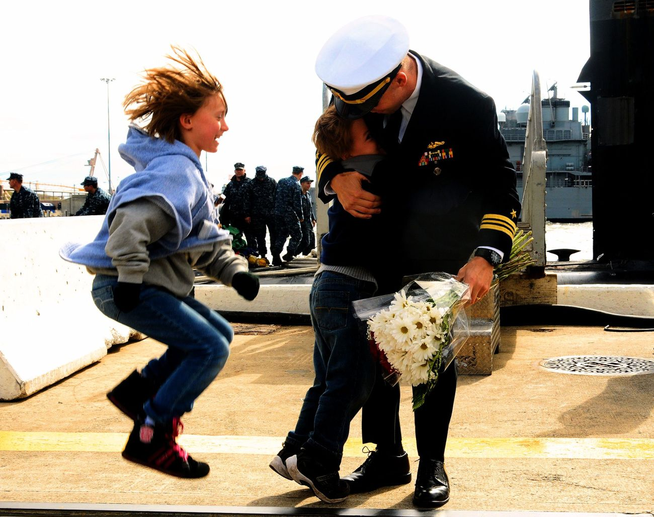 121103-N-EP471-023 Norfolk, Va. (Nov. 3, 2012) – Two young children welcome home their father and the crew of the Los Angeles-class attack submarine USS Norfolk (SSN 714) from a six- month deployment at Naval Station Norfolk, Va. Nov. 3. Commanded by Cmdr. Greg Zettler, Norfolk steamed more than 30,000 nautical miles during the deployment and conducted port visits to Haifa, Isreal; Limassol, Cyprus; Bahrain and Diego Garcia. U.S. Navy photo by Mass Communication Specialist 1st Class Kim Williams