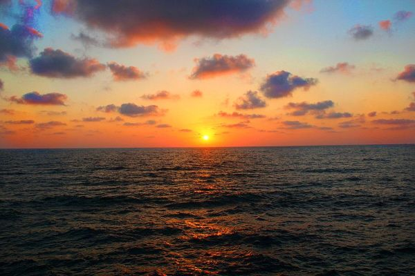 Peering at the sunset from the port of Tel Aviv, Israel.