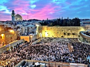 Worshipers at the Western Wall celebrating Shavuot in Jerusalem, Israel at dawn, May 26, 2012.