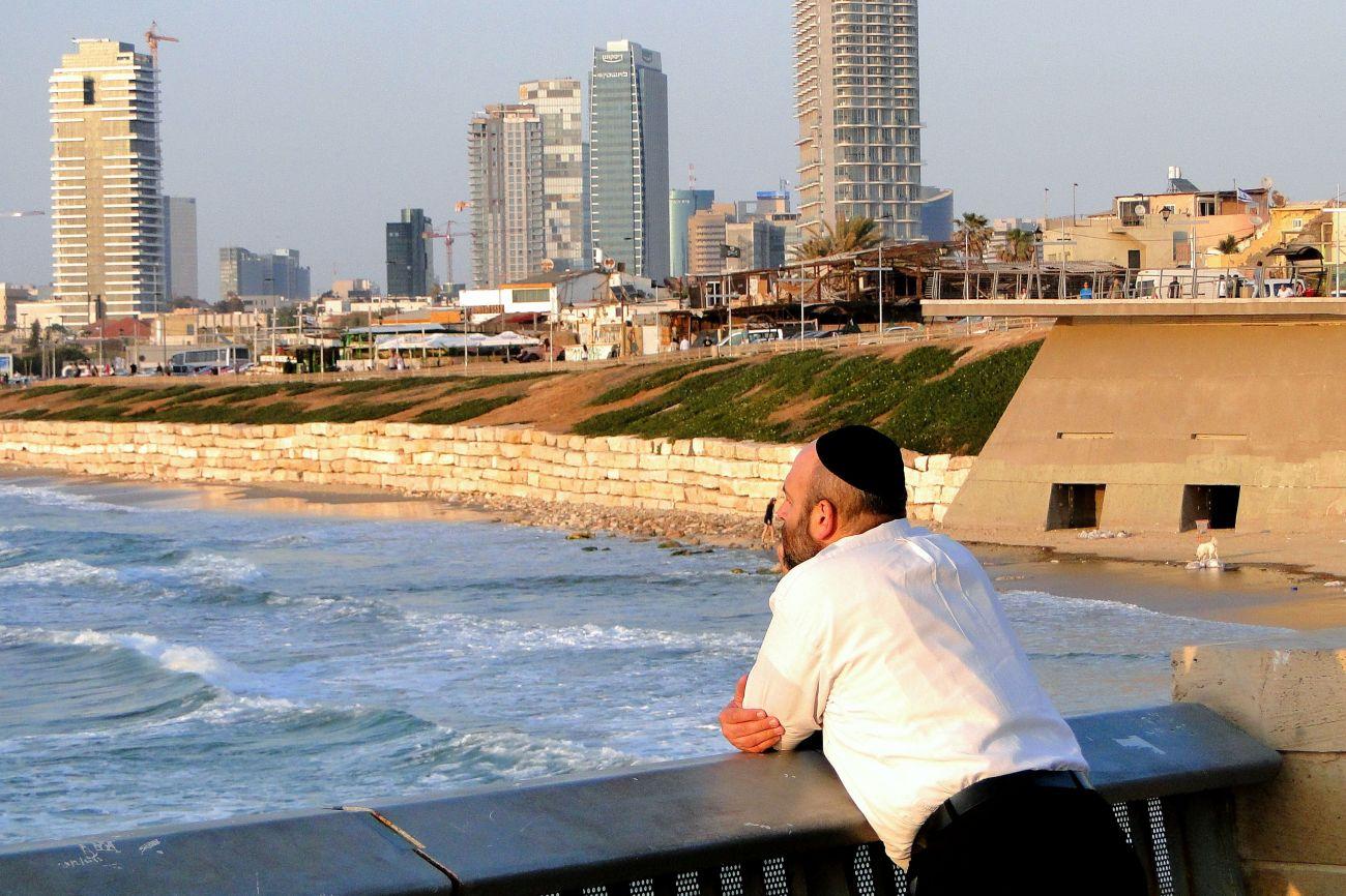 jewish_man_looks_out_over_tel_aviv_seashore_-_yafo_jaffa_-_israel_5714202250_t