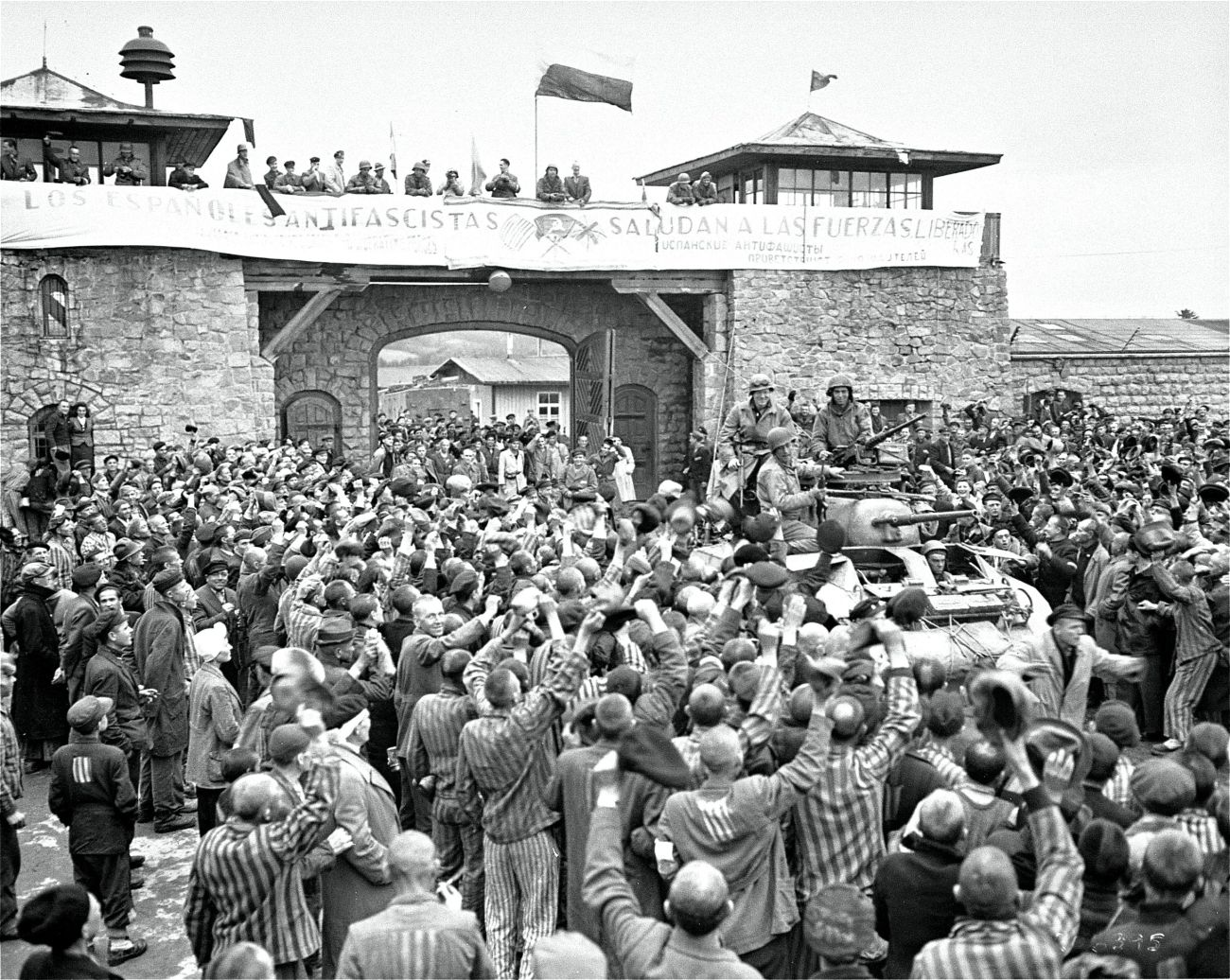 mauthausen_survivors_cheer_the_soldiers_of_the_eleventh_armored_division_t