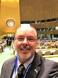 Rev. Charles E. McCracken in the General Assembly Hall of the United Nations.