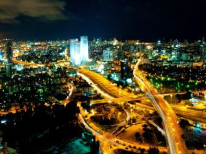 Tel Aviv Skyline illuminated at night.