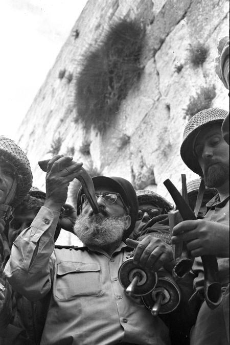 Army Chief Chaplain Rabbi Shlomo Goren stands surrounded by IDF soldiers and blows the shofar in front of the Western Wall in Jerusalem on June 7, 1967.