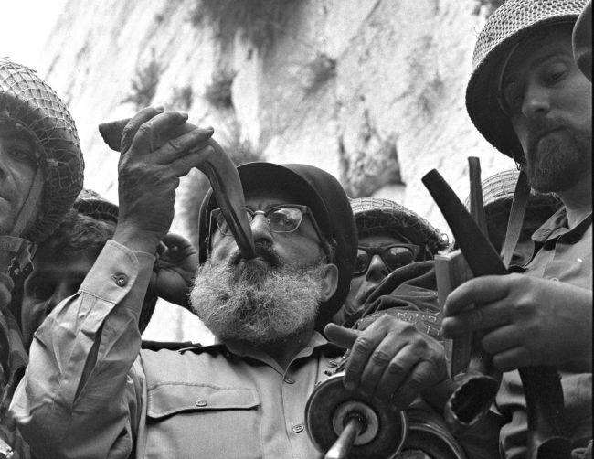 Detail: Army Chief Chaplain Rabbi Shlomo Goren stands surrounded by IDF soldiers and blows the shofar in front of the Western Wall in Jerusalem on June 7, 1967.