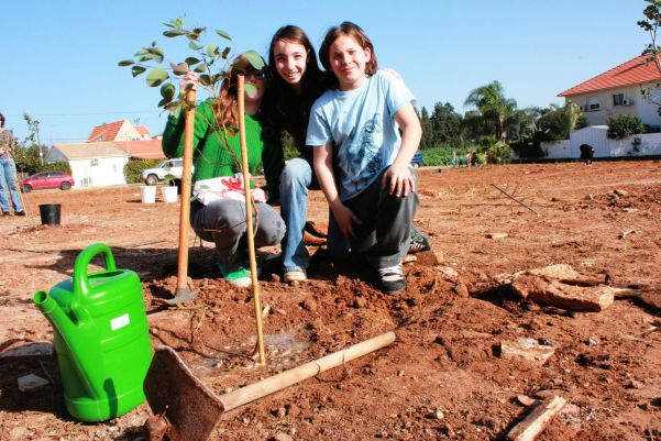 Kids in Israel plant trees for the future in a community project.