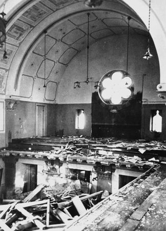 11_Prayerbooks lie scattered on the floor of the choir loft in the Zerrennerstrasse synagogue destroyed on Kristallnacht