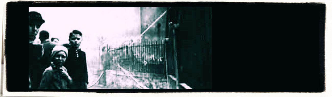 Burning synagogue on Kristallnacht in Nazi-Germany, November 10, 1938_header