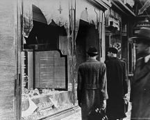 14_The day after Kristallnacht. German citizens look the other way on November 10 1938.