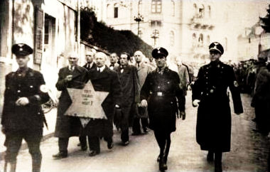 2_Jews forced to march with star on Kristallnacht